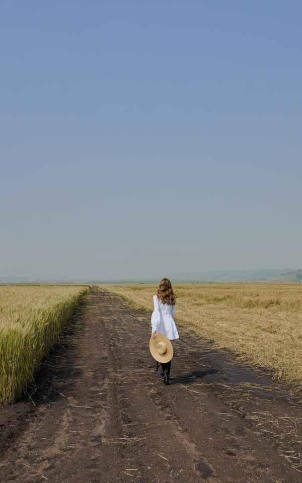 woman in white dress walking