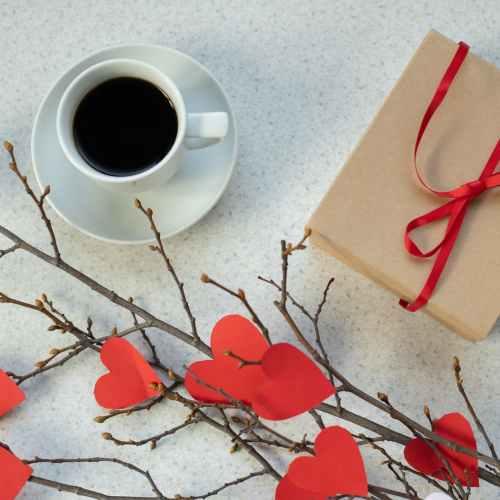 coffee near present and handmade bouquet