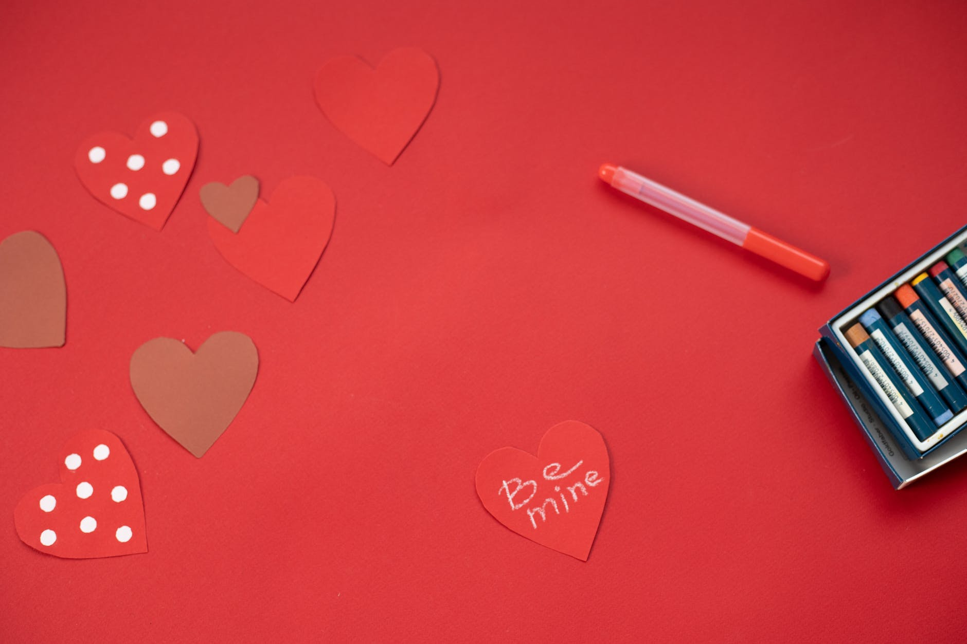 decorated paper hearts on table
