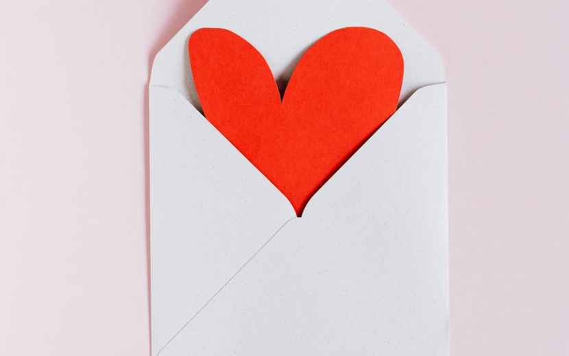 white envelope with red paper heart