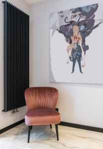 apartment interior with chair near painting on wall
