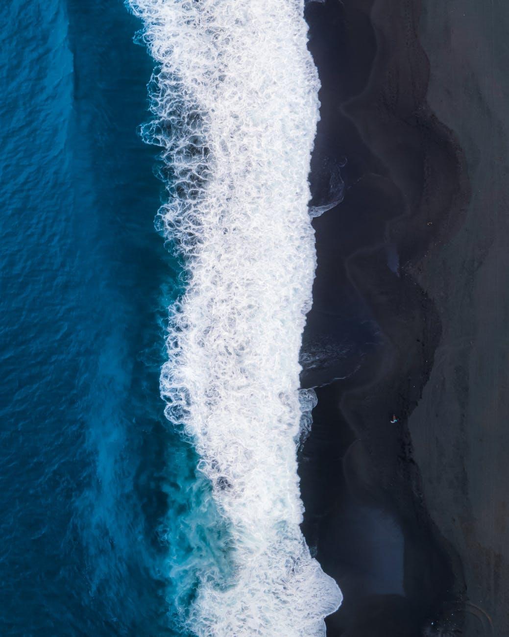 foamy sea splashing on coast