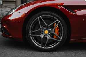 red car with gray wheel