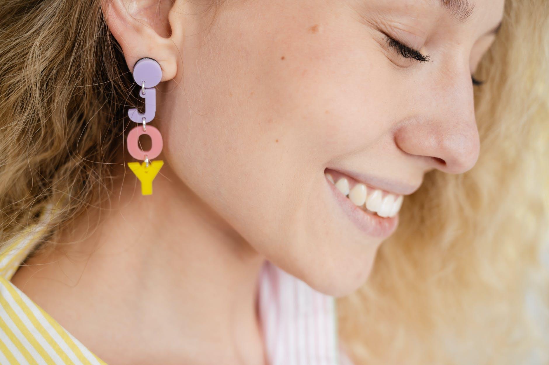 smiling woman wearing an earring