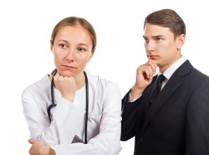 Doctor and her lawyer thinking about how to solve the problem