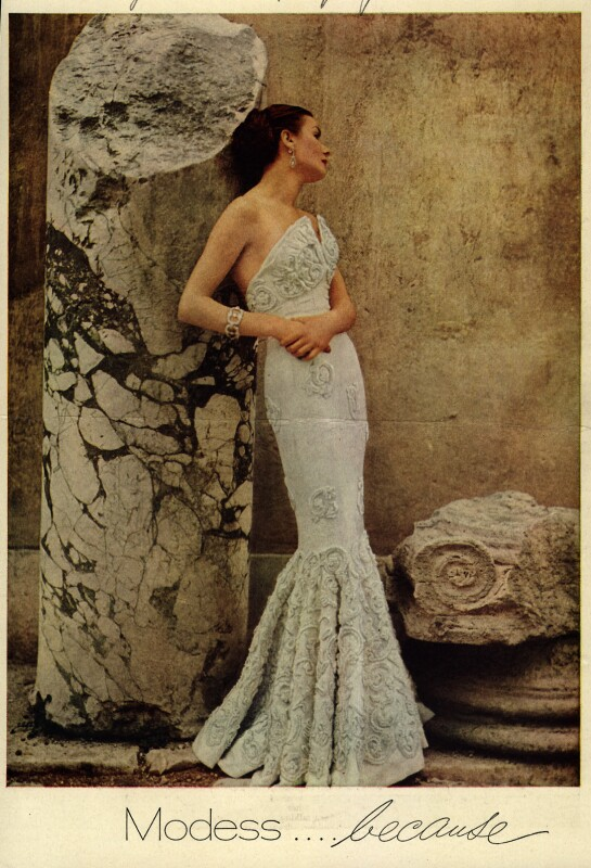 A Modess ad from 1950 showing a woman in an elegant, fitted evening gown. (Good Housekeeping/Ad*Access, Duke University Libraries)
