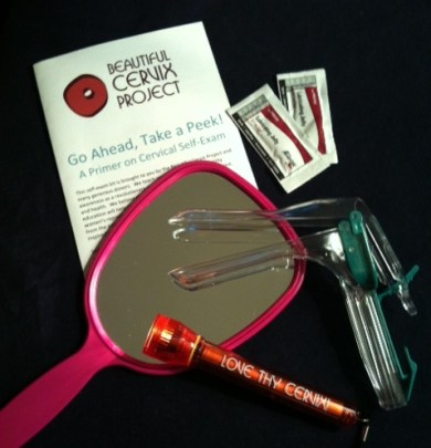 A self-exam kit including a mirror and a plastic speculum.