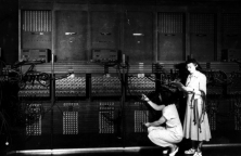 """""""Two women wiring the right side of the ENIAC with a new program, in the 'pre- von Neumann' days. Standing: Marlyn Wescoff Crouching: Ruth Lichterman."""" (Source: US Army Photo Public domain, via Historic Computers Images of the ARL Technical Library.)"""