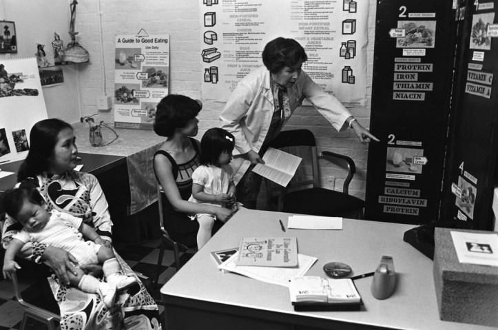 Photo of two mothers receiving nutrition information through the WIC program in June 1977. Photo courtesy of National Archives and Records Administration. (USDA/Flickr CC BY 2.0)