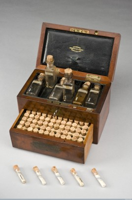 A wooden 19th-century homeopathic medicine chest full of vials
