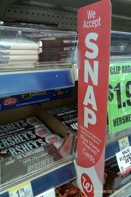 Grocery store candy bar display and SNAP sign