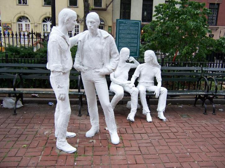 "Memorial to Stonewall and the gay liberation movement in Christopher Park, NY. Lesbian novelist and playwright Sarah Schulman decried these statues as ""two white clone-like thin gay men and two white, young lesbians with perfect noses""; a whitewashed version that omitted the Black drag queens who fought the police at the Stonewall Inn. (Sculptor: George Segal. NYC Parks)"
