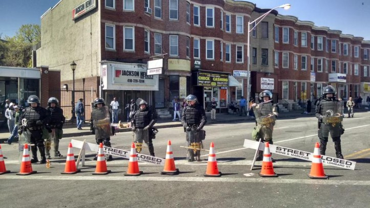 """State police in riot gear on Pennsylvania Avenue as volunteers clean up last night's looting. #BaltimoreRiots"" (Howard Koplowitz (@HowardKoplowitz)/Twitter)"