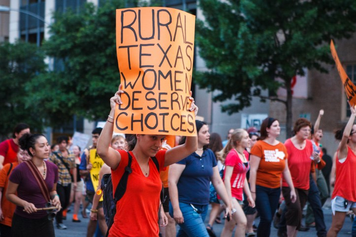 """Protest rally against HB2/SB1, with poster text: """"Rural Texas women deserve choices."""""""