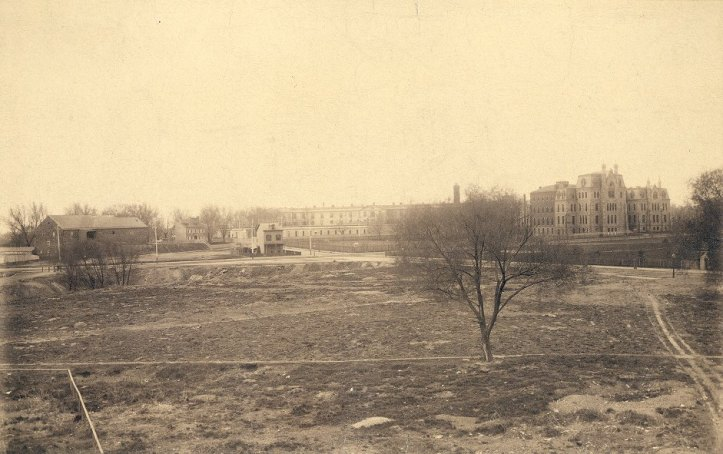 "The Blockley Almshouse Hospital of Philadelphia (""Old Blockey""), pictured in the background, 1892. (Wikimedia)"