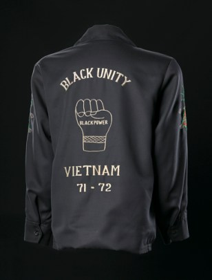 "Jacket proclaiming ""Black Unity - Vietnam,"" created by the Saha Union Group, Thailand (founded 1961), c. 1971-1972, on display at the NMAAHC. (Collection of the Smithsonian National Museum of African American History and Culture)"