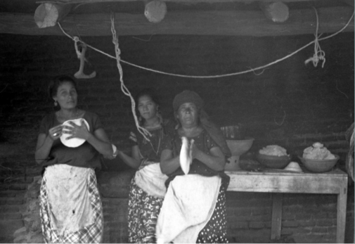 Amusgoz women patting the dough between their hands to shape tortillas, while a pile of masa sits behind them. (Instituto Nacional de Antropología e Historia, Mexico)