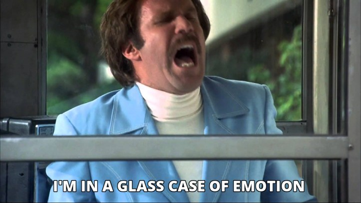 Screenshot of Will Ferrell's character in Anchorman in a phonebooth with the text 'I'm in a glass case of emotion!'