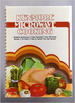 Photo of the cover of the Kenmore Microwave Cooking cookbook depicting a whole chicken and produce