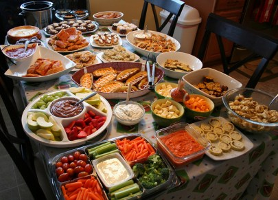 Another table covered in dishes of finger foods, including lots of carrots.