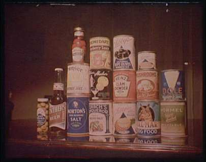 Photograph of a stack of canned food, including clam chowder, salt, and tuna fish.