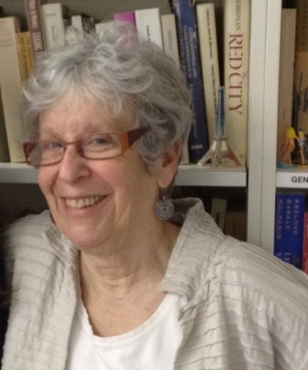 Joan Wallach Scott in front of a book shelf.