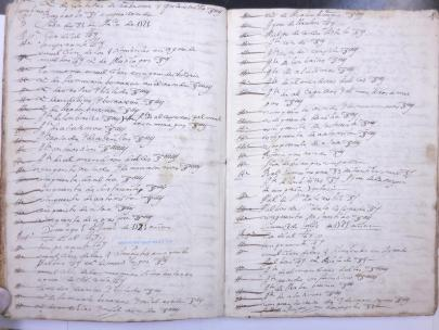 An open book with yellowed pages and rows of handwritten log entries.