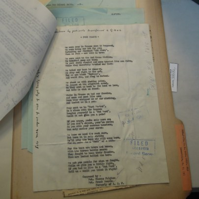 A copy of a typed poem stored in an archive folder.