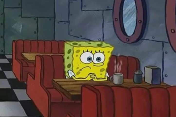 Spongebob Squarepants sitting alone in a diner booth sadly staring at a steaming mug.