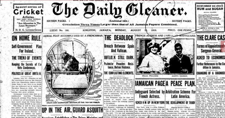 "The front page of a 1910 newspaper titled The Daily Gleaner with a headline story titled ""Jamaican Page, Bodyguard selected by French actress"" with a grainy photo of a light-skinned woman and a dark-skinned man standing next to each other."