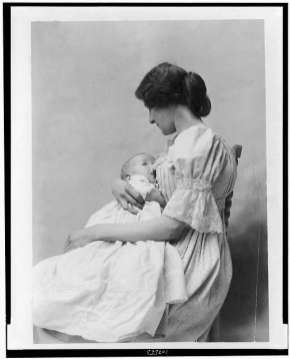 Mother holding baby. (Library of Congress)
