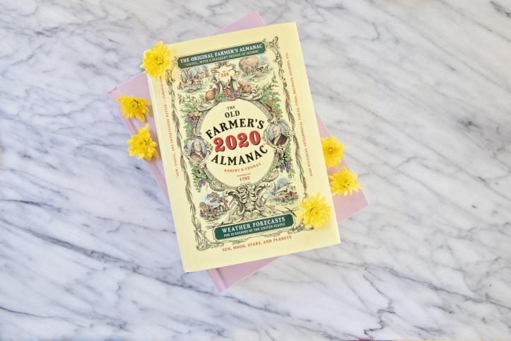A photograph of the 2020 Farmer's Almanac on a marble surface.