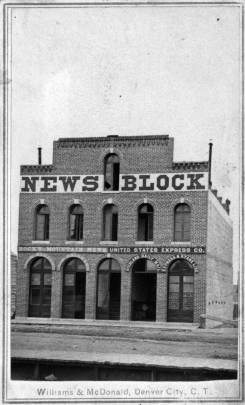 A brick building with NEWS BLOCK written across the top.