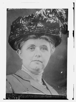 Headshot of Katherine Davis in a large perhaps taffeta or velvet hat.