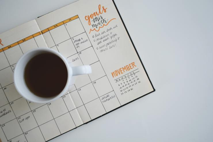 A picture of a calendar with a cup of coffee.  It symbolizes scheduling an appointment with one of Nurtured Well, LLCs nurse practitioners to get help with anxiety and depression.