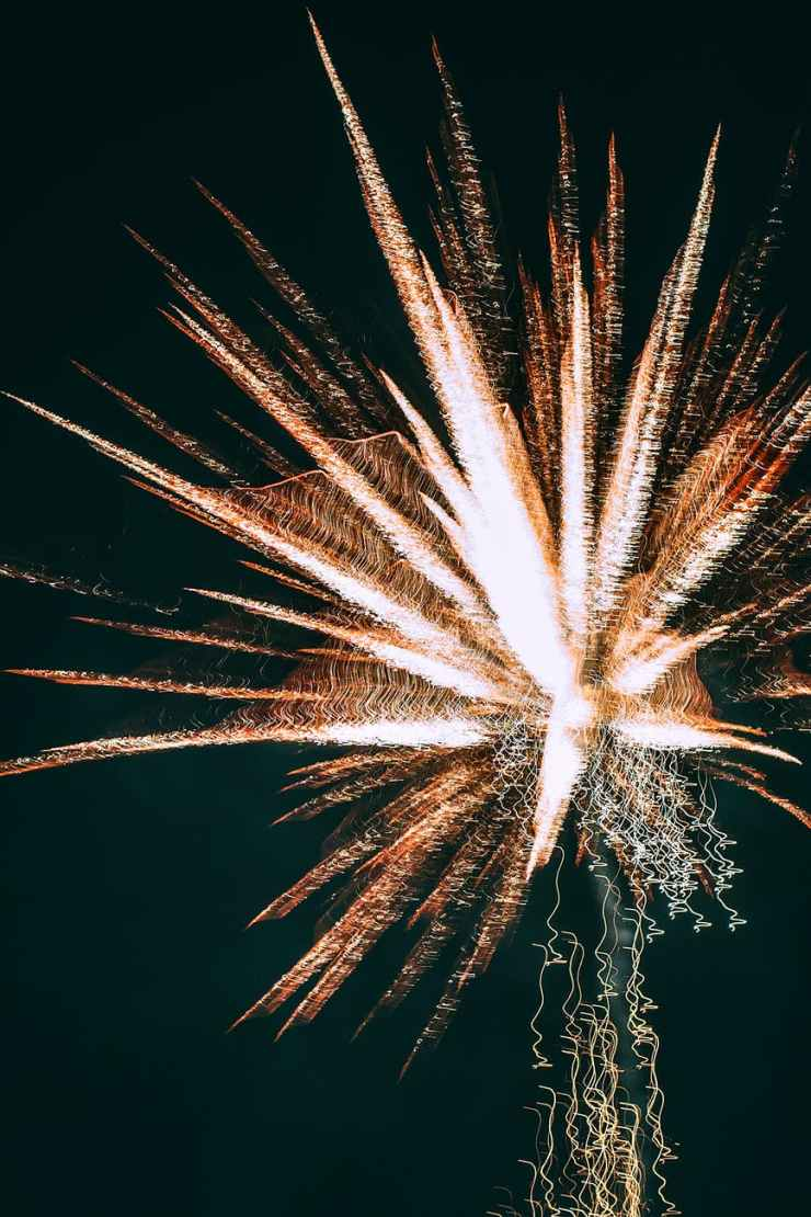 Glowing bright fireworks in dark sky. This represents how the brain may feel when manic.  WOmen can get help for bipolar disorder at Nurtured Well, LLC in Towson, MD 21204