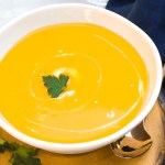 Instant Pot Butternut Squash Soup in white bowl garnished with cream and parsley