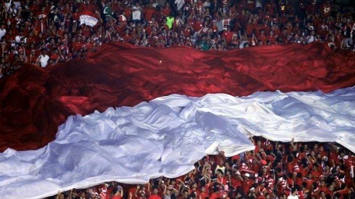 Lautan suporter Indonesia saat dukung timnas di piala AFF. Foto via @indonesia_xii