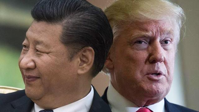 Xi Jinping dan Donald Trump bersaing pada KTT Davos. Foto via rappler