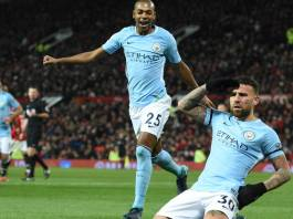 Manchester City's Argentinian defender Nicolas Otamendi (R) celebrates scoring their second goal during the English Premier League football match between Manchester United and Manchester City at Old Trafford in Manchester, north west England, on December 10, 2017. / AFP PHOTO / Oli SCARFF / RESTRICTED TO EDITORIAL USE. No use with unauthorized audio, video, data, fixture lists, club/league logos or 'live' services. Online in-match use limited to 75 images, no video emulation. No use in betting, games or single club/league/player publications. / (Photo credit should read OLI SCARFF/AFP/Getty Images)