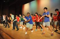 Students dancing mass dance on stage