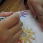 Outlining the flower onto wax paper