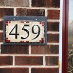 A Cream House Number Plaque With Red Accents For A Brick Home Nutmeg Designs Margaret Almon Wayne Stratz