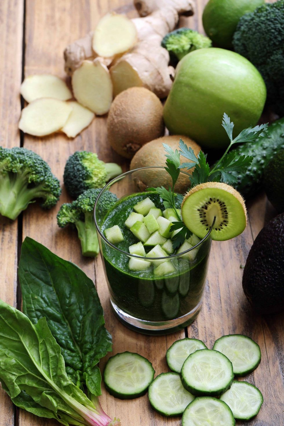Green smoothie with chopped green vegetables