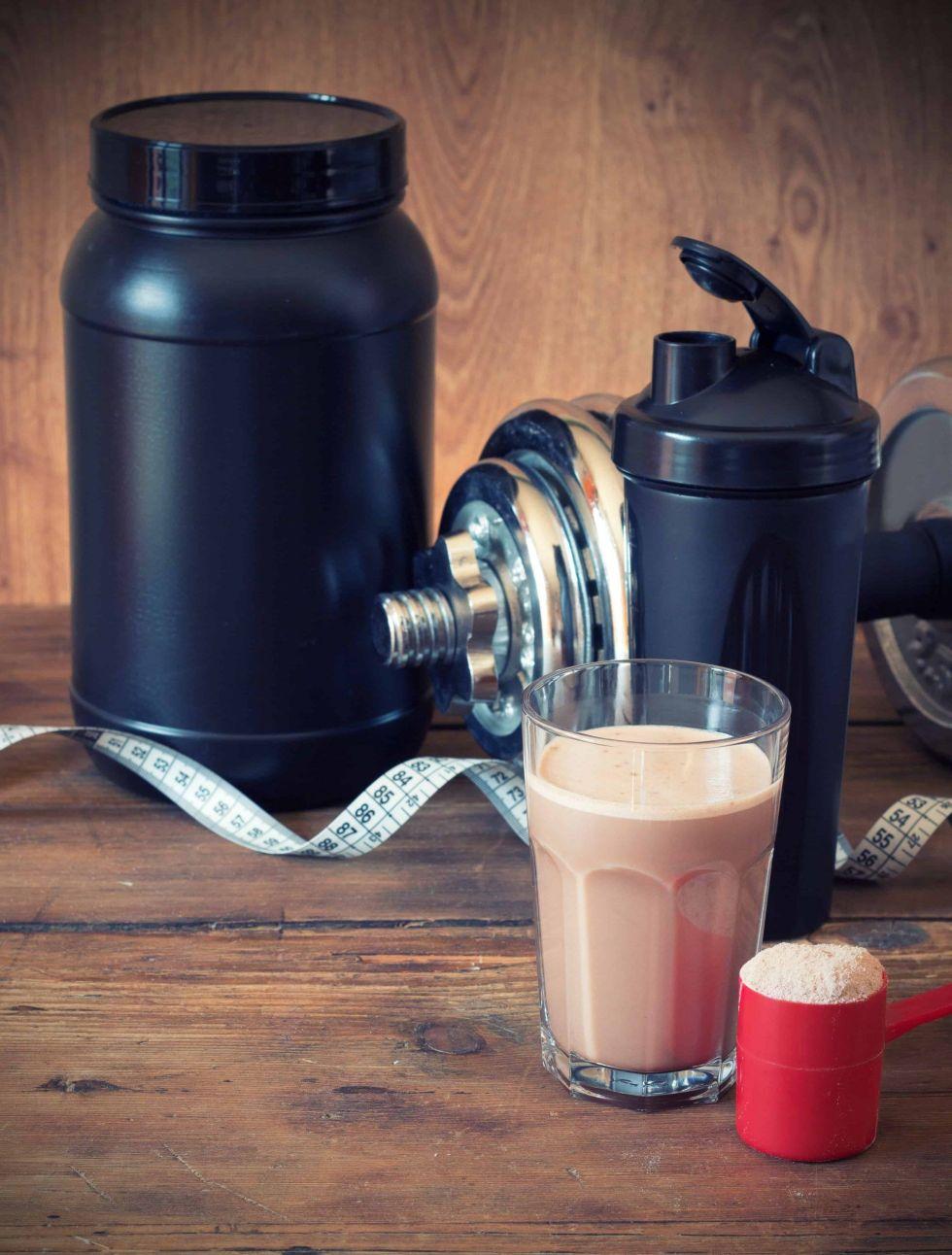 Protein shake next to a protein shake blender