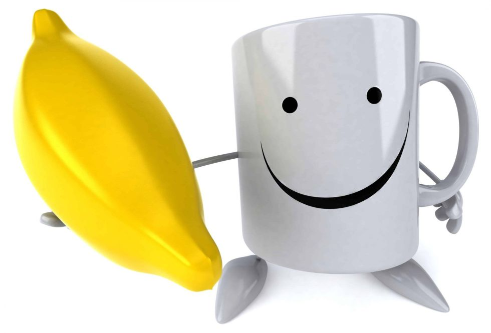 a mug holding a banana