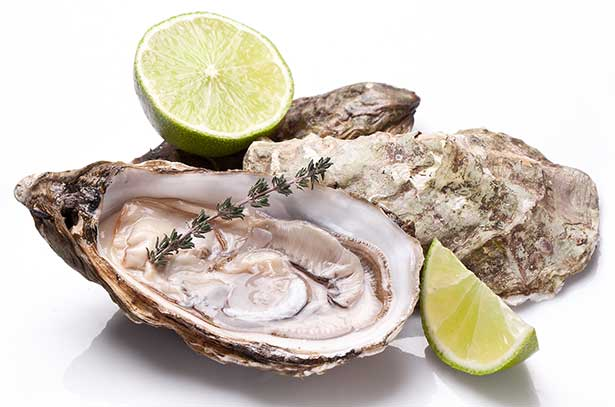 Picture of an oyster With Half a Lime - shellfish and seafood.