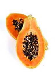 Two Papaya Halves Showing Orange Flesh and Seeds Inside.