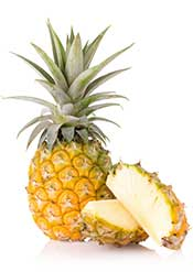 Whole Fresh Tropical Pineapple and Two Pineapple Slices.