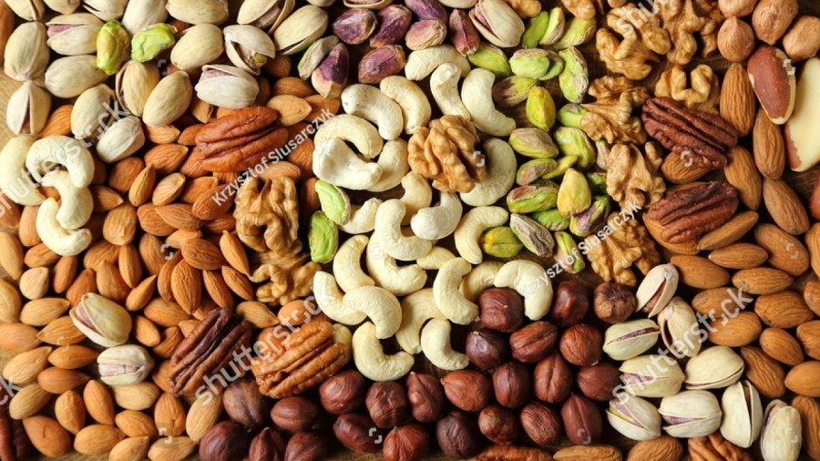stock-photo-natural-background-made-from-different-kinds-of-nuts-407297545.jpg